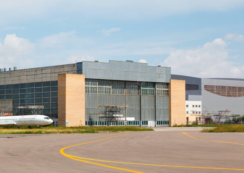 Aircraft hangar with blue sky. 2013 stock image
