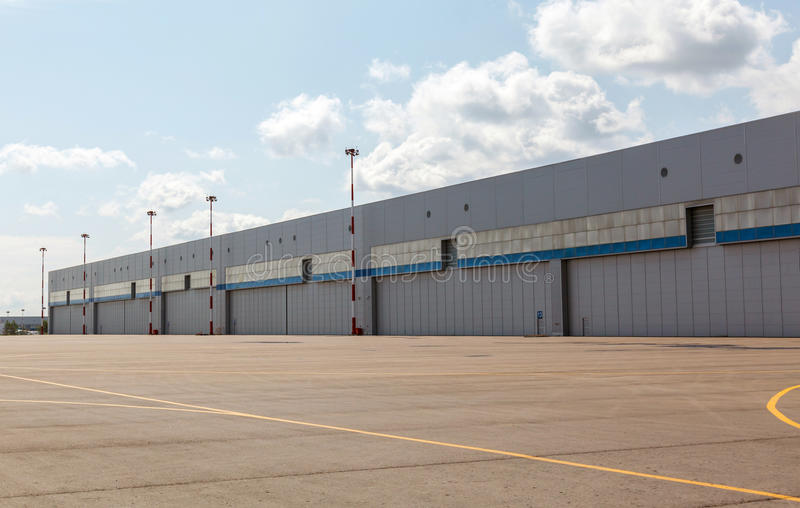 Aircraft hangar with blue sky. 2013 royalty free stock images