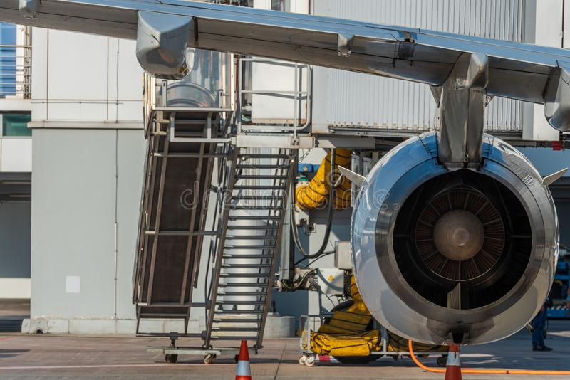 Aircraft jet engine detail in the exposition. Turbine Engine Profile. Aviation Technologies. Airport background royalty free stock photography