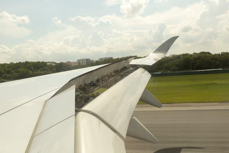 Aircraft landing. At the runaway of the airport royalty free stock photo