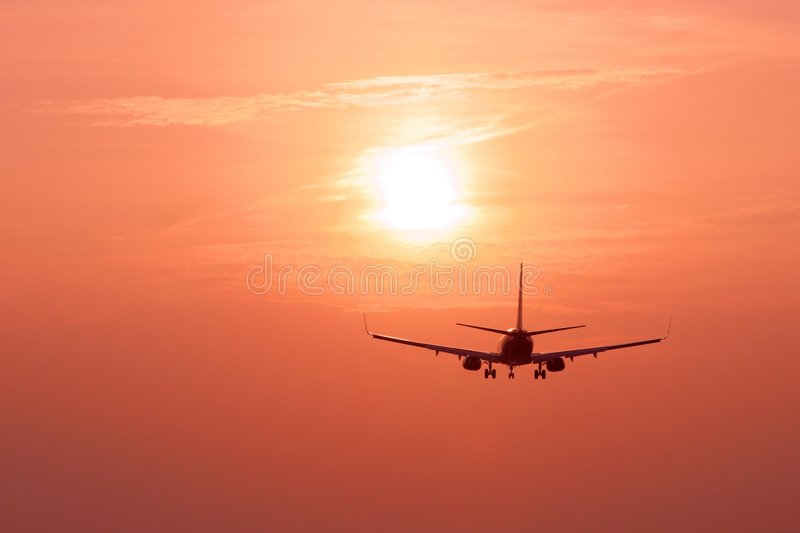 Aircraft landing at dusk stock photos