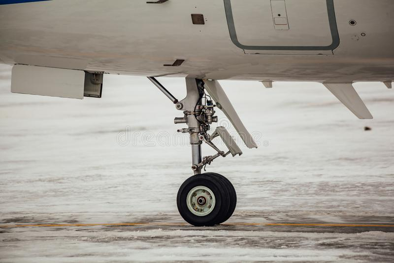 Aircraft landing gear. On winter snow, close up stock photos