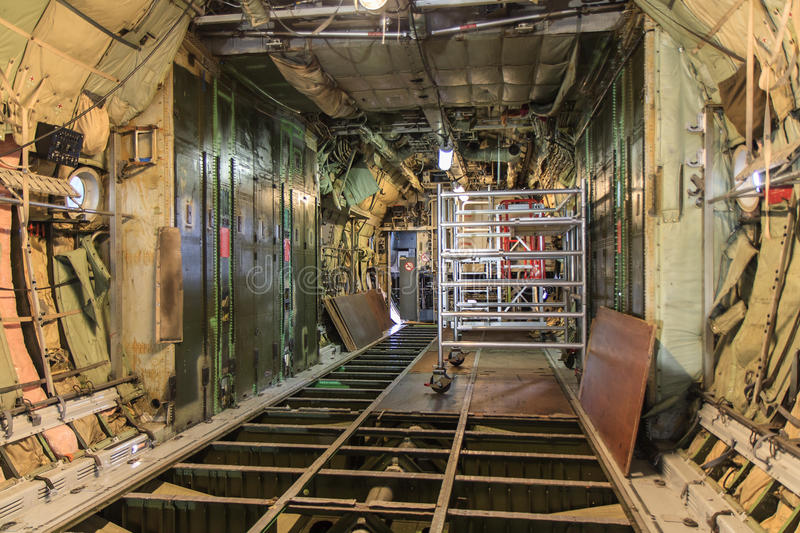 Aircraft maintenance. Stripped interior of a military transport plane during maintenance stock photo