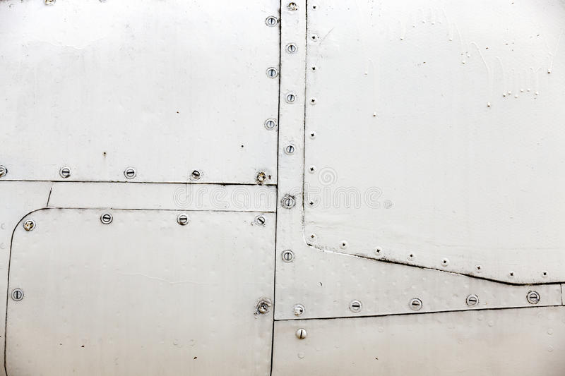 Aircraft metal cladding. Photographed close-up of metal siding military plane in gray, close-up, small depth of field royalty free stock images