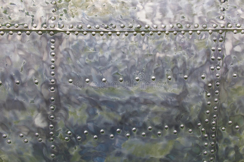 Aircraft metal. Peeled paint-covered aircraft with rivets stock images
