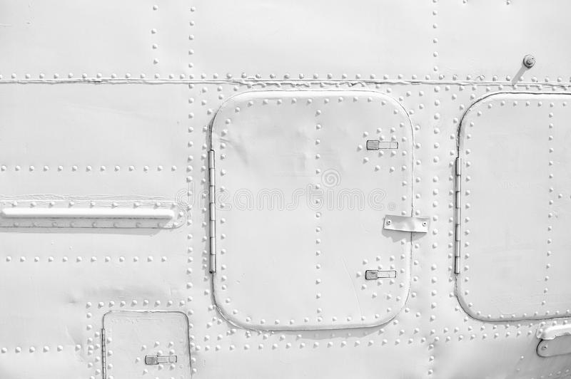 Aircraft metal plating texture with rivets. Background stock photography