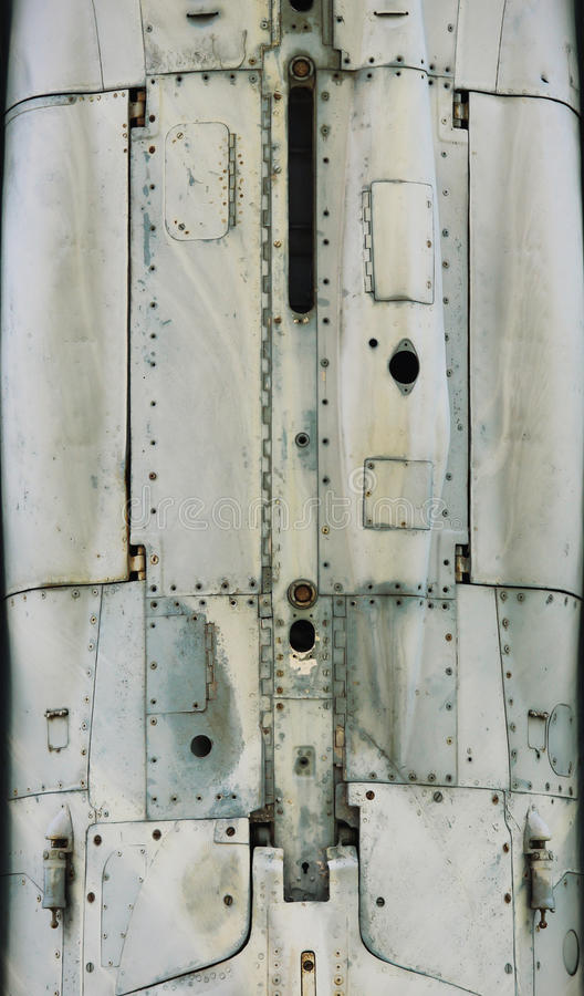 Aircraft metal surface with aluminum and rivets.  royalty free stock images