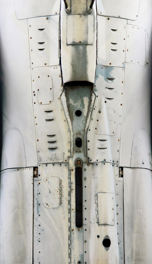 Aircraft metal surface with aluminum and rivets.  royalty free stock image
