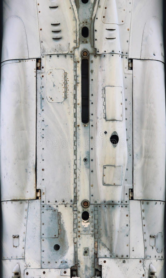 Aircraft metal surface with aluminum and rivets.  royalty free stock photos