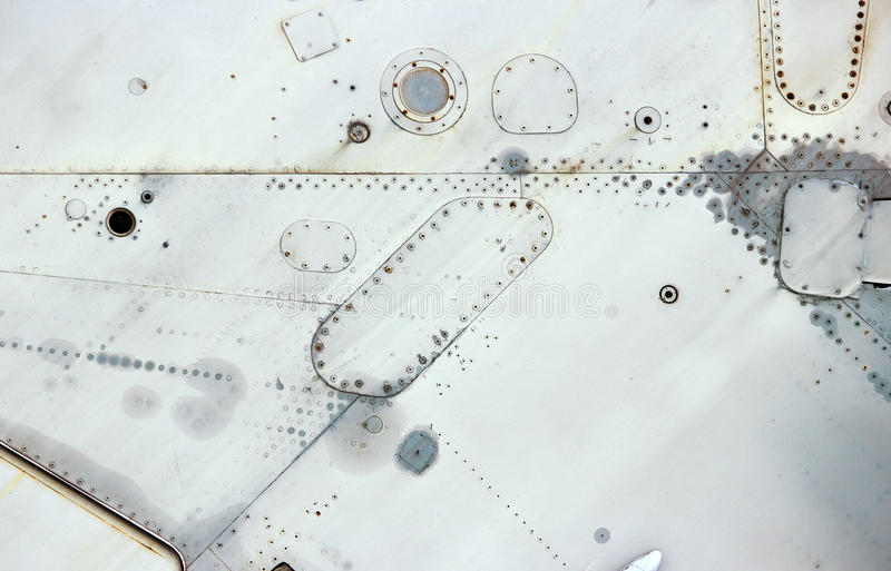 Aircraft metal surface with aluminum and rivets royalty free stock photography