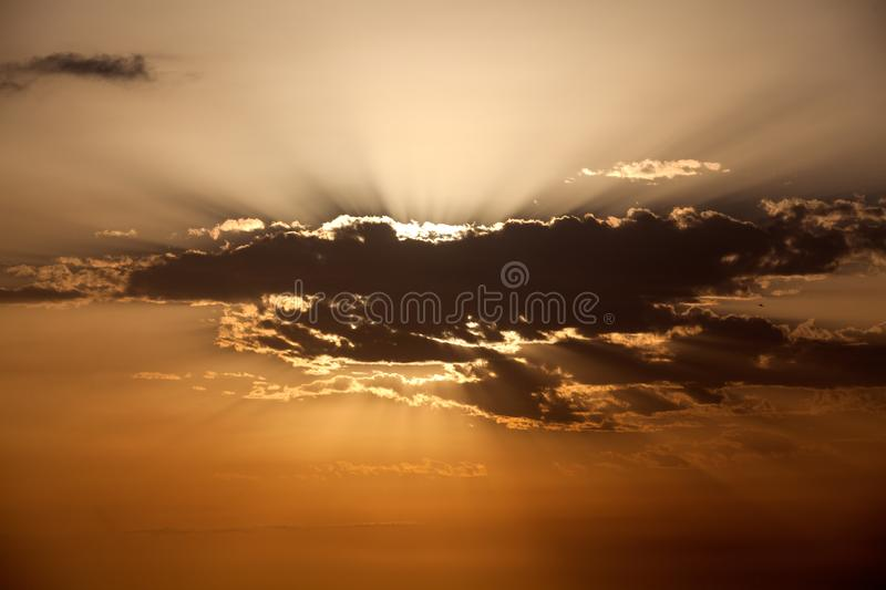 Aircraft from morning clouds over sea royalty free stock photo