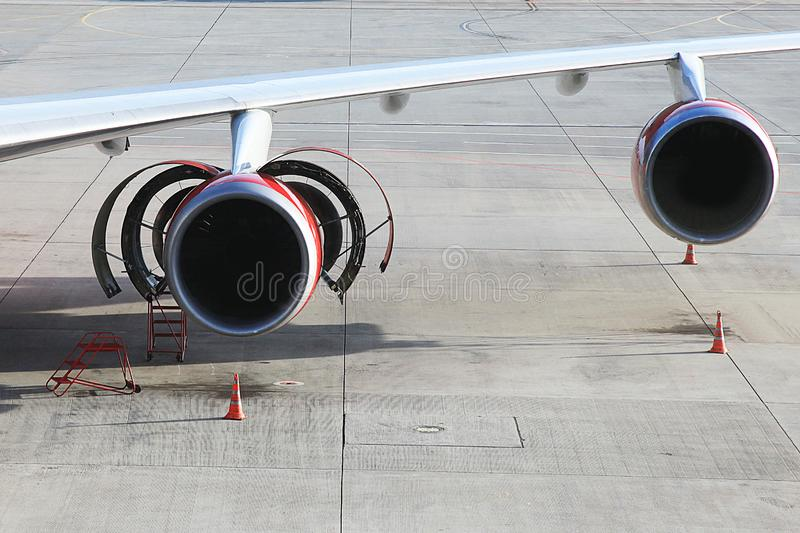 Aircraft with open engine. Passenger airplane on maintenance of engine in airport stock images