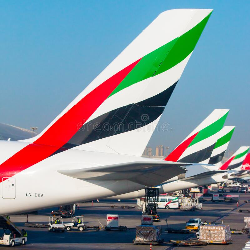 The Emirates aircraft rudders on Dubai International Airport. stock photography