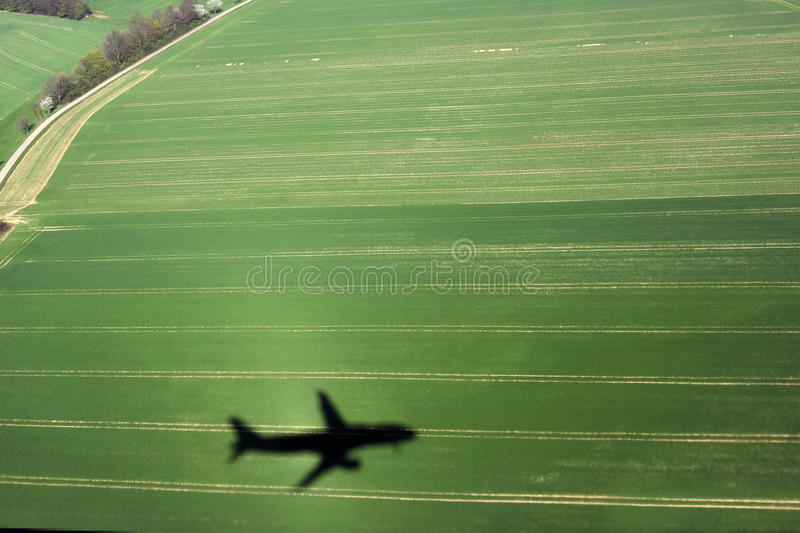 Aircraft shadow. Landing, shadow of an aircraft over royalty free stock photos