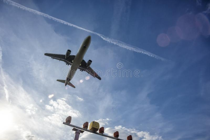 Aircraft shortly before landing on the runway. Aircraft shortly before landing on the final approach to the airport stock photo