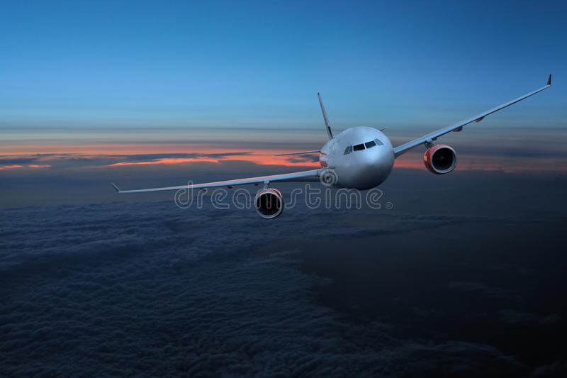Aircraft in the sky at night stock photography