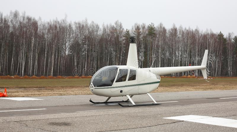 Aircraft - Small white helicopter side view royalty free stock images