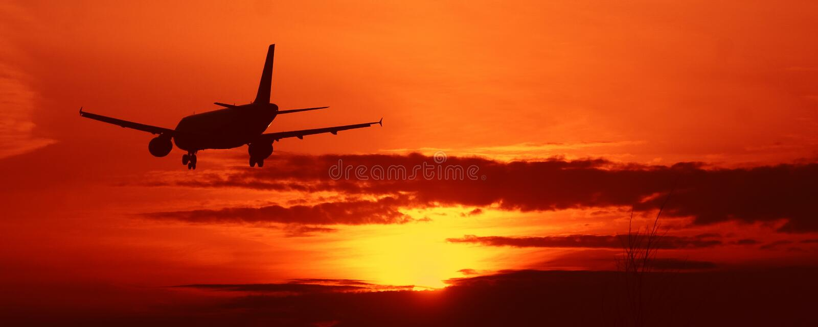 Aircraft on sunset sky. Aircraft on beautiful sunset sky stock image