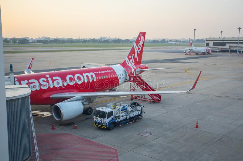 The Aircraft of Thai AirAsia waiting for the passengers at the Don Mueang international airport stock image
