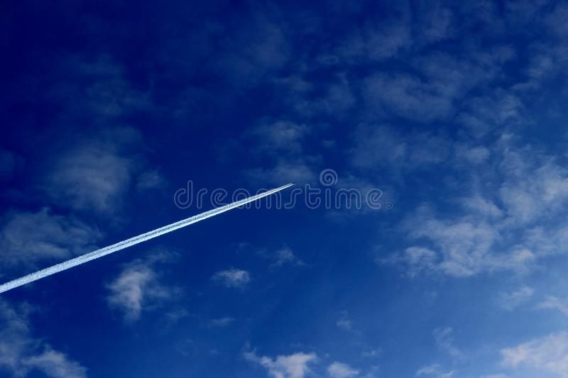 Aircraft trail across the sky royalty free stock photo