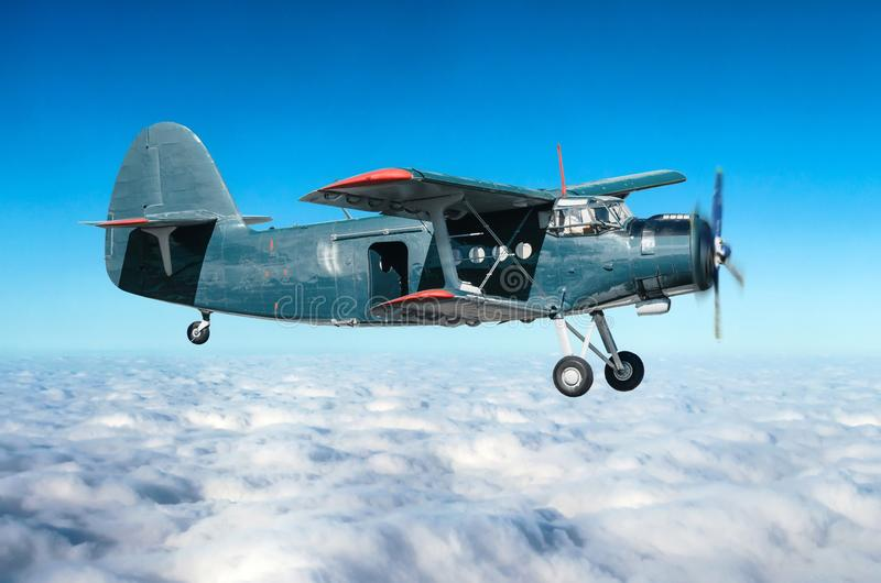 Aircraft turboprop biplane at high altitude in the sky above overcast with an open door. Aircraft turboprop biplane at high altitude in the sky above overcast royalty free stock image