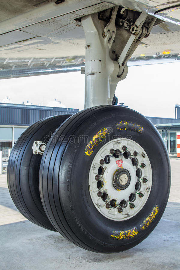 Aircraft undercarriage landing gear. Amsterdam Schiphol Airport, North Holland/the Netherlands - March 10 2016: undercarriage of KLM Fokker 100 passenger royalty free stock photos