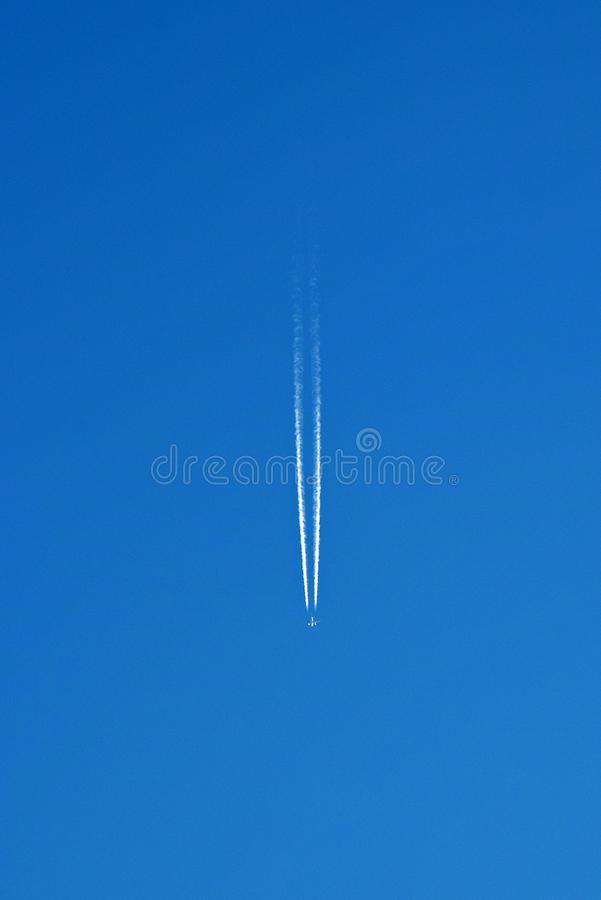 Aircraft Vapour Trail With Blue Sky Background royalty free stock images