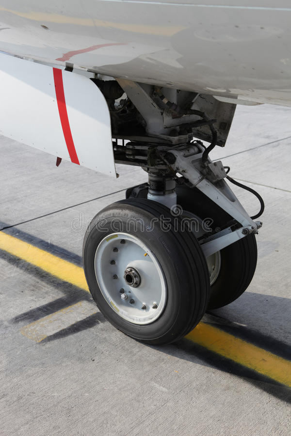 Aircraft wheel. On airport runway royalty free stock photos