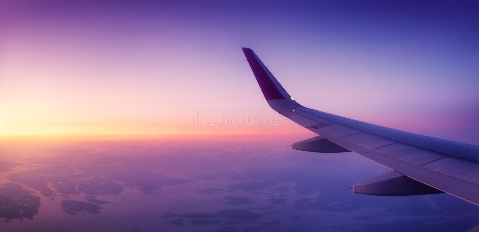 Aircraft wind on the sunrise sky background. Composition of aircraft. Air transport. Travel by airplane. Travel - image royalty free stock photo