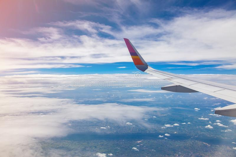 Aircraft Wing on blue sky and white clouds background. Airbus, airfoil, airline, airplane, window, atmosphere, beautiful, business, cardon, clean, daytime royalty free stock image