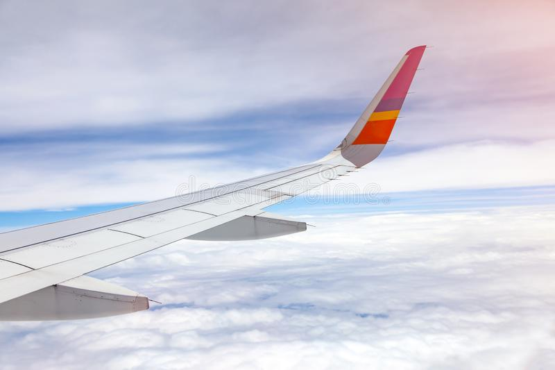 Aircraft Wing on blue sky and white clouds background. Airbus, airfoil, airline, airplane, window, atmosphere, beautiful, business, cardon, clean, daytime royalty free stock photo