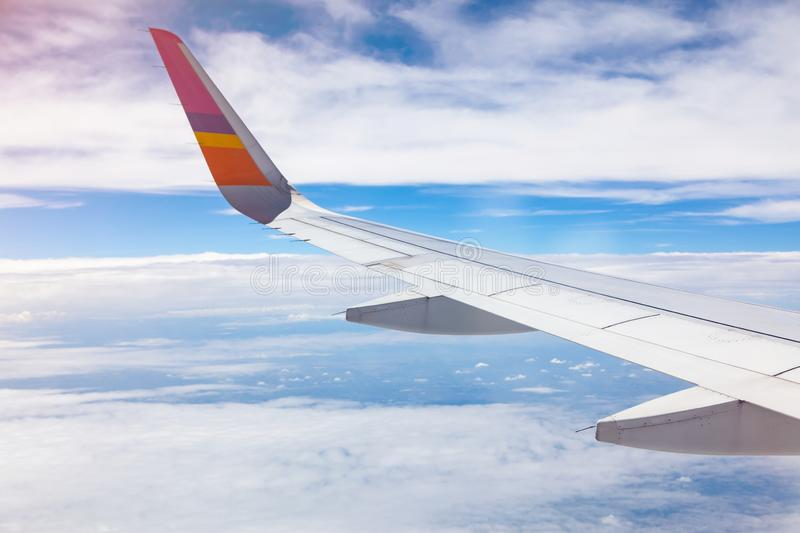 Aircraft Wing on blue sky and white clouds background. Airbus, airfoil, airline, airplane, window, atmosphere, beautiful, business, cardon, clean, daytime stock image