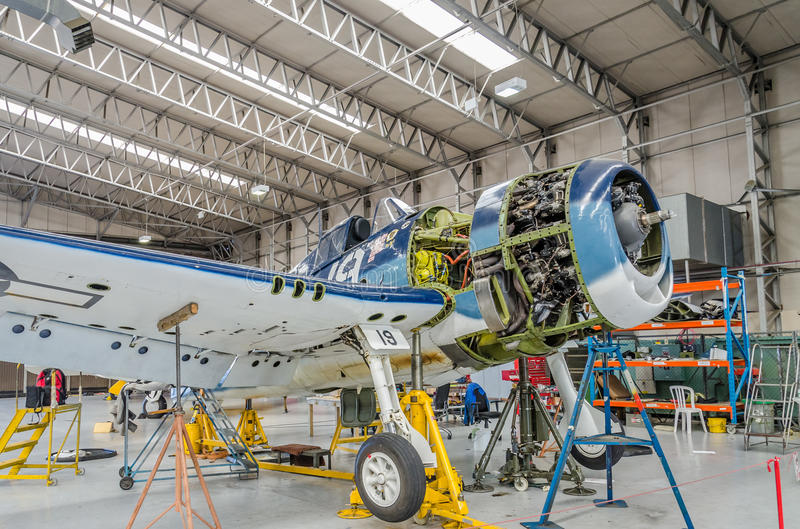 Aircraft in workshop. Warbird Hellcat in US.Navy colours being repaired in before air show season in Duxford,UK stock images