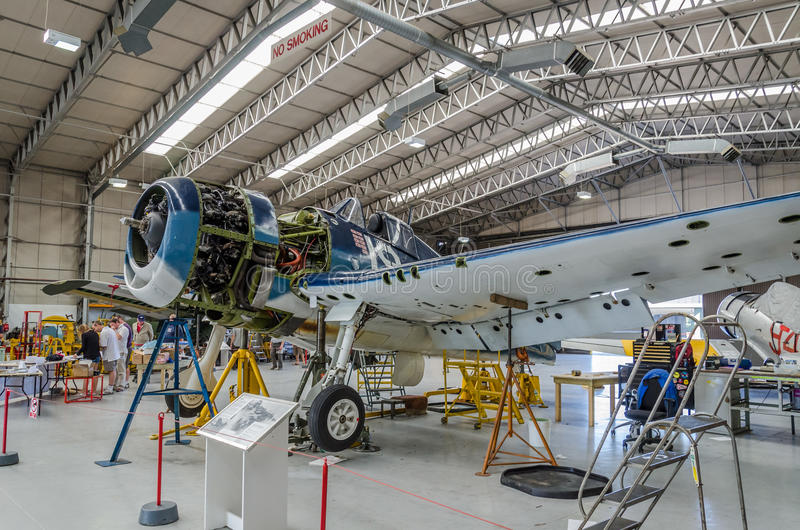 Aircraft in workshop. Warbird Hellcat in US.Navy colours being repaired in before air show season in Duxford,UK royalty free stock images