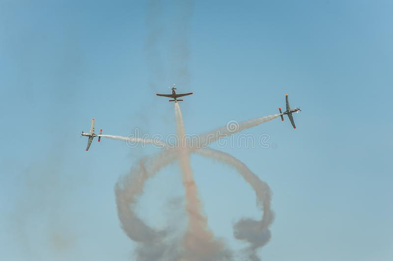 Aircrafts shows great shows and leaves behind a smokes in the sky stock photo