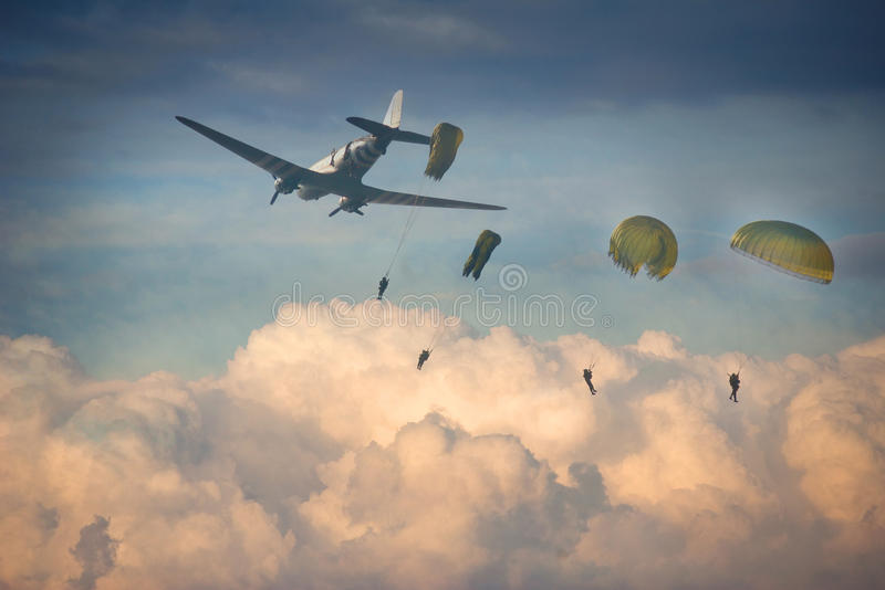 Airdrop of four paratroopers. Airdrop of four paratroopers jumping from military plane during an invasion royalty free stock photos