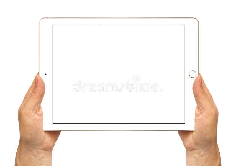 Aire 2 del iPad del oro en las manos de la mujer imágenes de archivo libres de regalías
