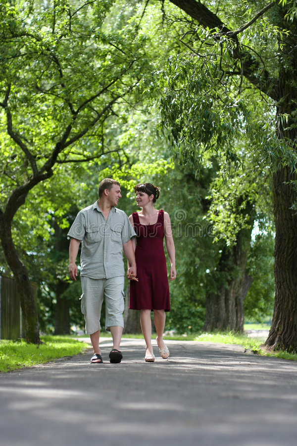 Airing. Loving couple walking in park stock images