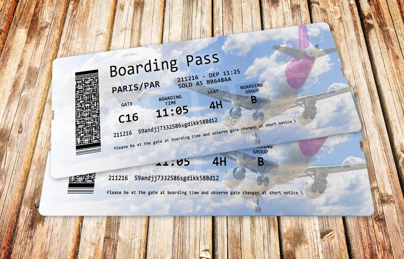 Airline boarding pass tickets on wooden background - The contents of the image are totally invented and does not contain under. Copyright parts. The background stock photo