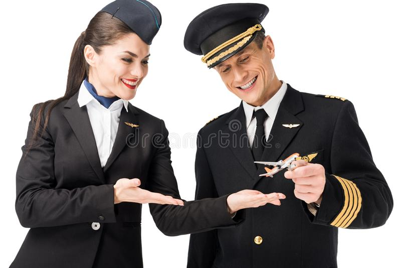 Airline crew stewardess and pilot holding toy plane stock photo