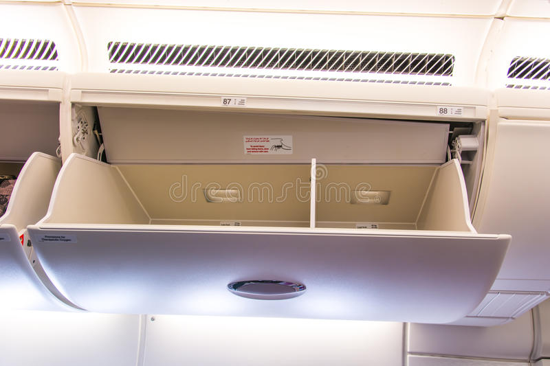 Airline overhead storage compartment stock photo