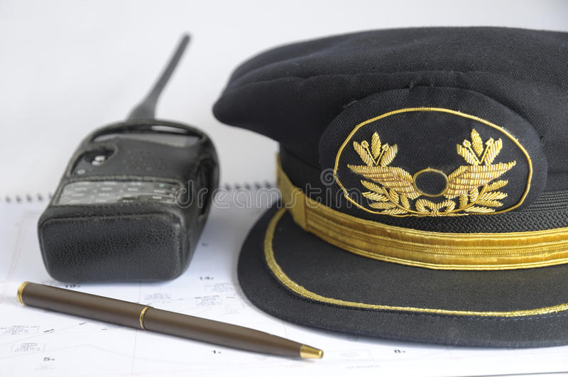 Airline pilot hat. Flight plan and airline pilot hat stock image