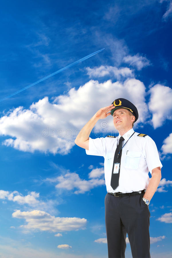 Airline pilot looking upwards royalty free stock image