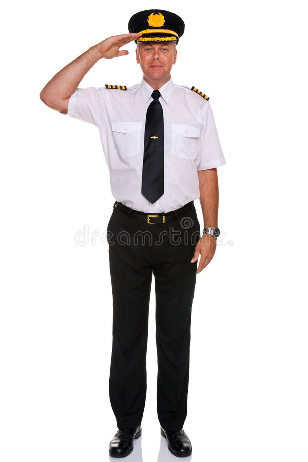 Airline pilot salute. Photo of an airline pilot wearing the four bar Captains epaulettes saluting, isolated on a white background stock image