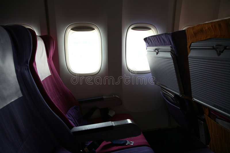 Airline seats. With open windows stock photo