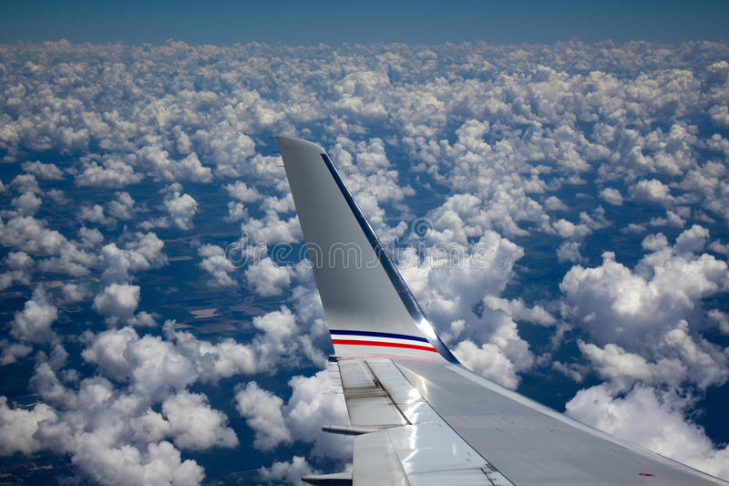 Airline Wing in the clouds stock images