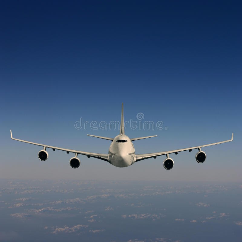 Airliner. An Airliner in Flight over Clouds stock photos