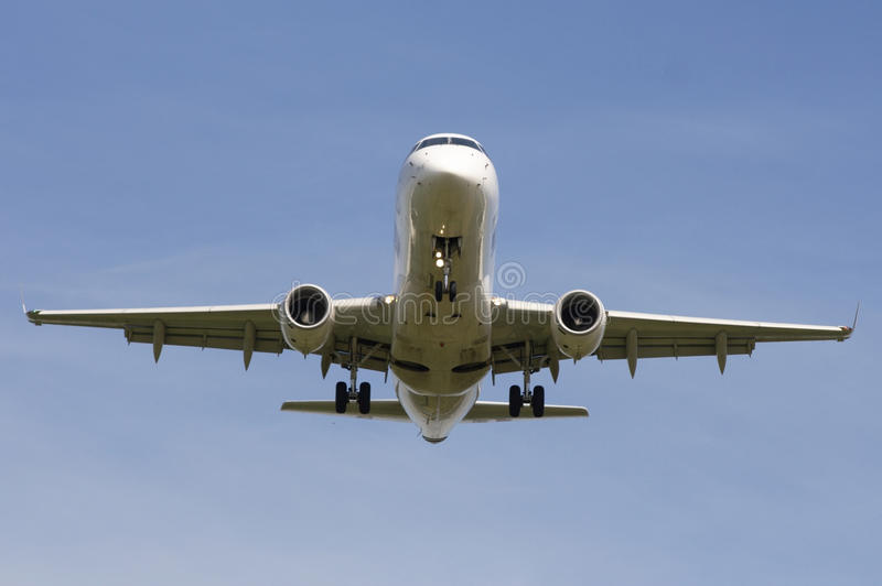Airliner approaching runway stock photo