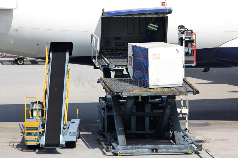 Airliner being loaded. With unit load device stock photography