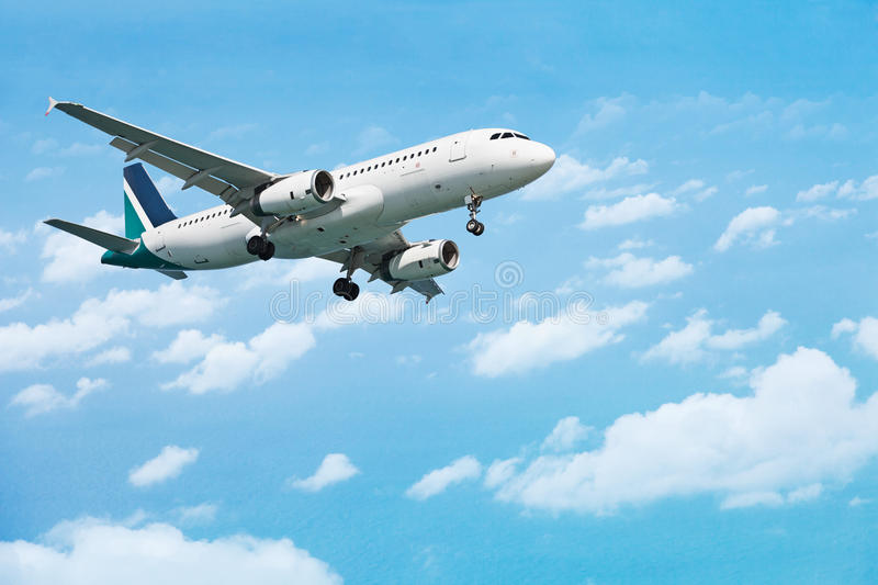 Download Airliner on the cloudy sky stock image. Image of direction - 22770677